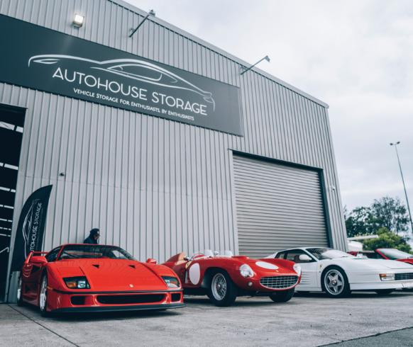 Lined up luxury cars outside AutoHouse Storage