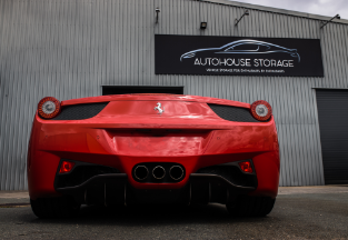 Rear end of a red luxury car